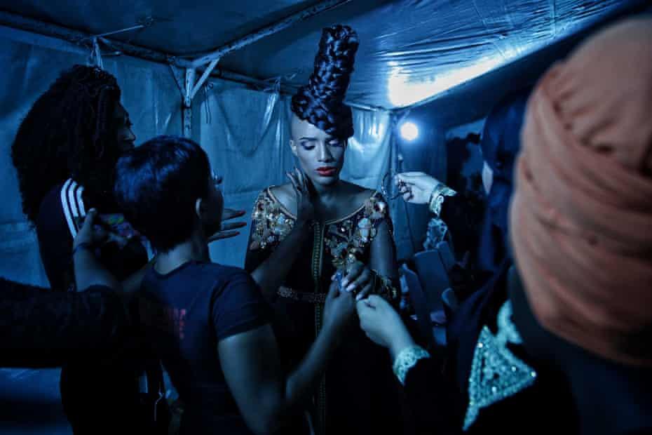A presenter gets ready backstage during Dakar fashion week, July 2017