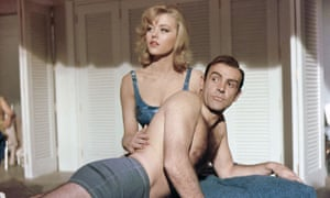 Margaret Nolan as the masseuse Dink with Sean Connery as James Bond in Goldfinger (1964).
