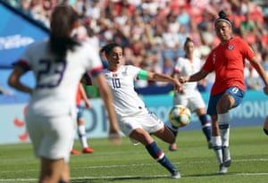 Carli LLoyd slams home the first goal.