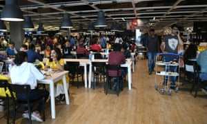 Customers eat at the IKEA restaurant.