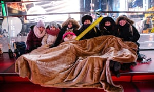 New Year revellers bundle up against the cold in Times Square, New York.