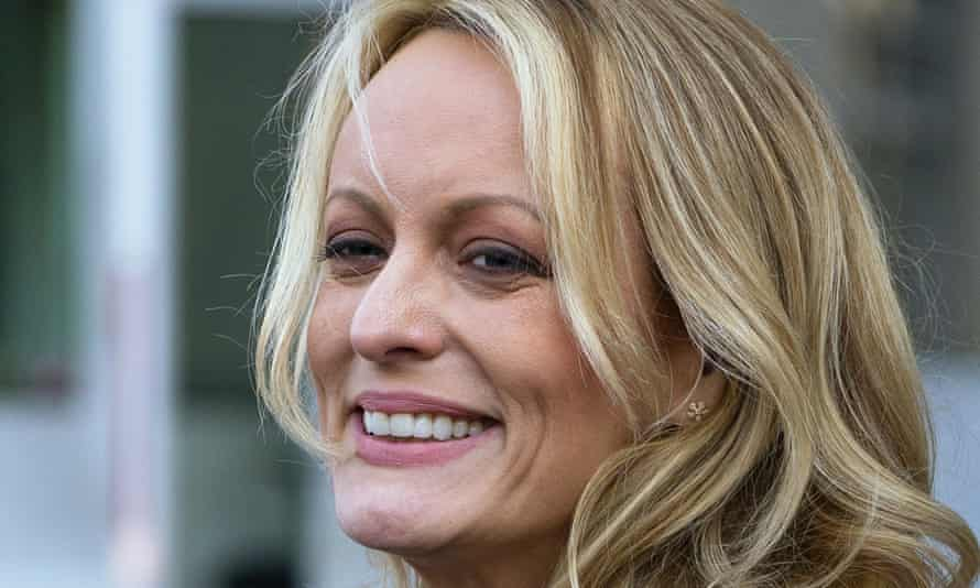 Stormy Daniels speaks to reporters outside court in New York in 2018.