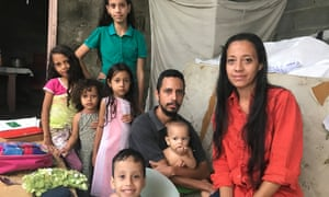 Ivan Henríquez with his wife and six children at their home in Barquisimeto