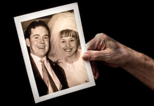 Tom Ledson holds a photograph of his wedding day