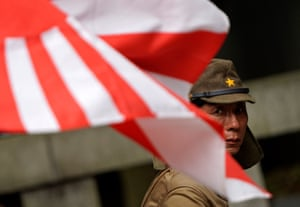 Tokyo, Japan A man dressed in imperial military uniform at the controversial Yasukuni shrine for war dead, on the anniversary of Japan's surrender in the second world war