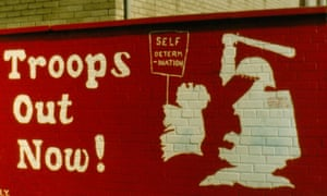 One of the many photographs of a mural saying Troops out now! taken by London-based architect Peter Moloney.