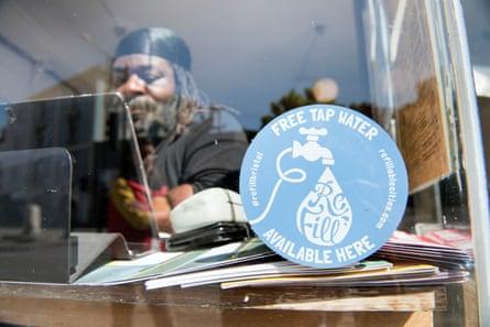 A Refill campaign sticker in the window of Cafe Kino in Stokes Croft, Bristol