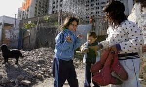 Children play in the Hidden City settlement.