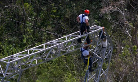 Whitefish Energy Holdings workers restore power lines damaged by Hurricane Maria in Barceloneta, Puerto Rico on 15 October 2017.