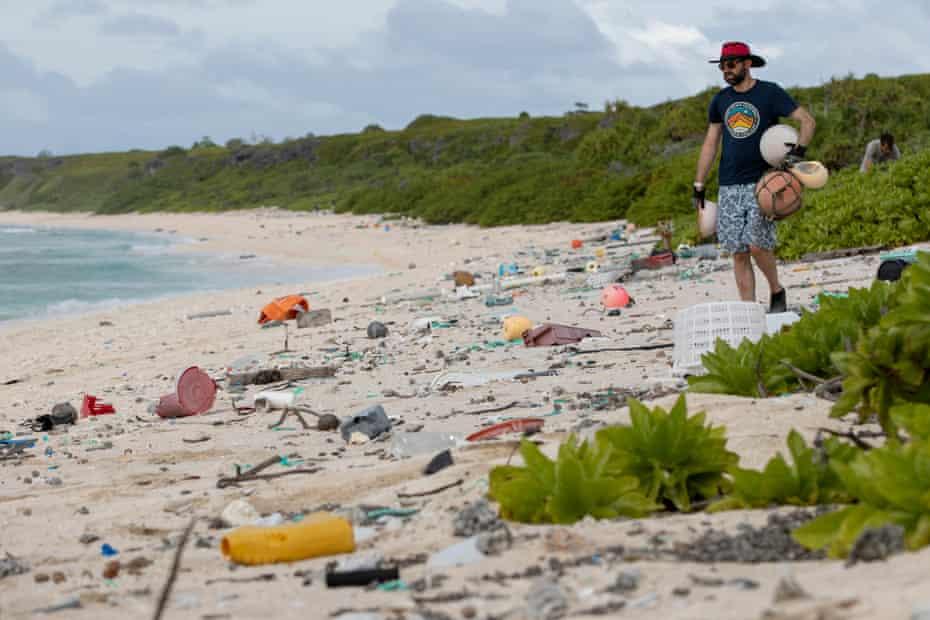 James Beard picks up rubbish on East beach.