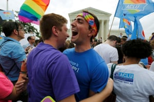Gay rights supporters celebrate after the supreme court ruled that the US constitution provides same-sex couples the right to marry, outside the supreme court building in Washington<br>