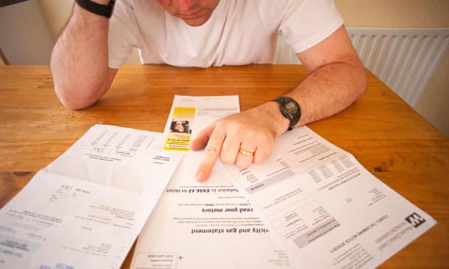 A man worrying over his household bills in the UK