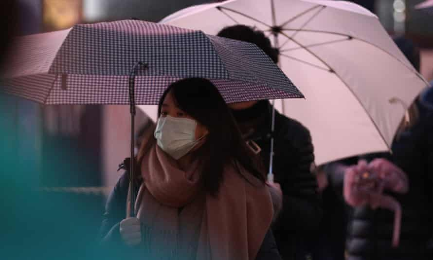A woman wearing a face mask in central London.