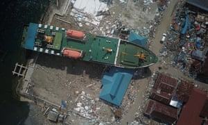 Aerial photo taken on Wednesday shows a cargo ship washed up in Donggala, Central Sulawesi.