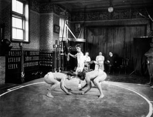 Japanese sumo wrestlers at a training session in 1923