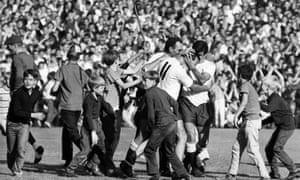 Spurs fans and players celebrate against Manchester United in September 1966 when they won 2-1.