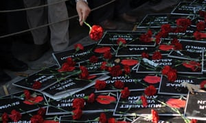 A man lays flowers on cards