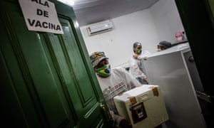 Health workers get ready for a vaccination journey, at the Aldeia Sao Felix, Autazes municipality, Amazonas state, Brazil, 05 February 2021.
