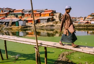 An algae-filled pond with a makeshift bridge adjacent to one of the few latrines, Balukhali refugee settlement, Cox's Bazar, 2018