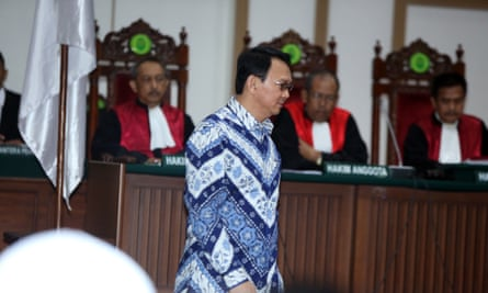 Governor Basuki Tjahaja Purnama, popularly known as Ahok, arrives in court for the verdict and sentencing in his blasphemy trial.