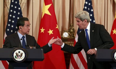The Chinese foreign minister, Wang Yi, holds a joint news conference with the US secretary of state, John Kerry, in Washington on Tuesday.