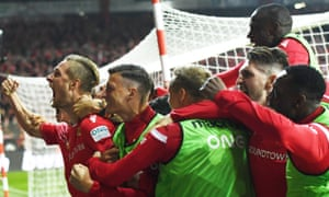 Sebastian Polter (left) celebrates scoring with his Union Berlin teammates after scoring in their Bundesliga derby victory.