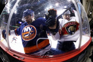 Adam Pelech (No 3) of the New York Islanders and Brian Boyle of the Florida Panthers crash the boards during their game at Barclays Center in New York