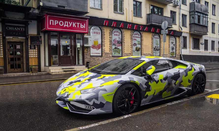 US authorities worked in coordination with Britain's National Crime Agency, which published a sphotographs and video of the hacker's lavish lifestyle, including his camouflaged car.