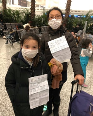 Jeff Siddle's wife, Sindy, and daughter, Jasmine; at the airport the family were asked to wear medical reports around their necks
