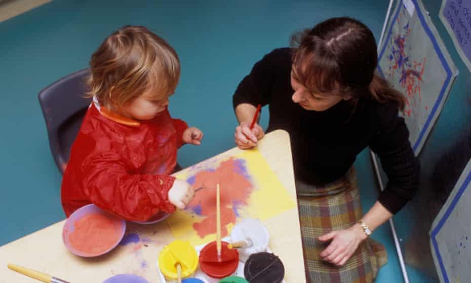 Teacher and child in a UK nursery.
