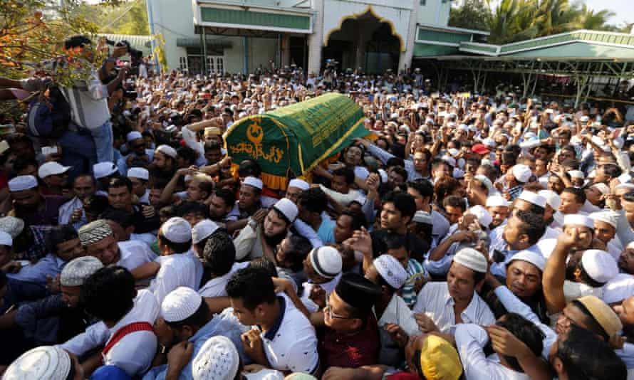 People carry the coffin of Ko Ni during the funeral service at the Muslim cemetery in Yangon.