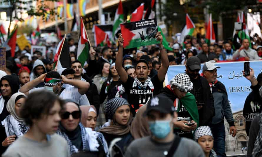 Protesters march in a Free Palestine demonstration in Sydney
