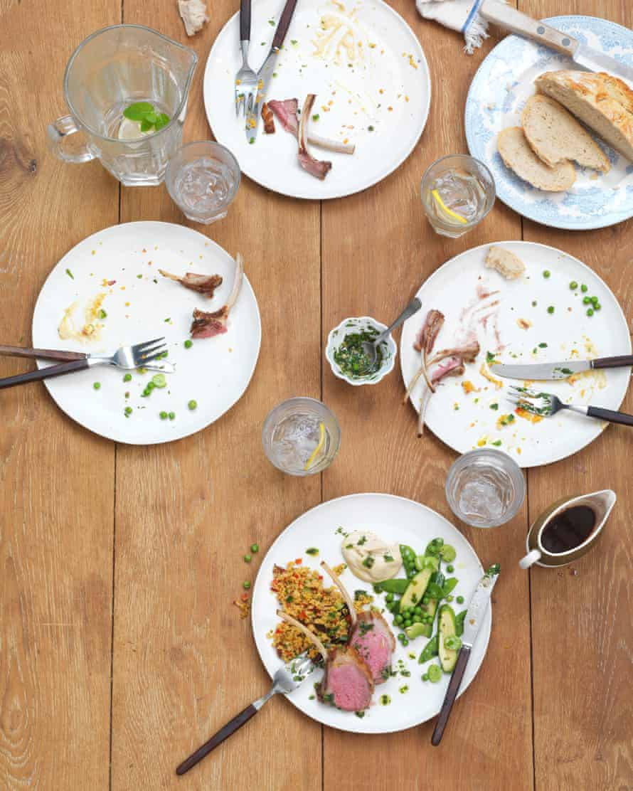Family dinner table with food eaten apart from one plate