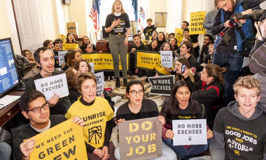 Members of the Sunrise Movement advocate for the Green New Deal in Nancy Pelosi's office on 10 December.