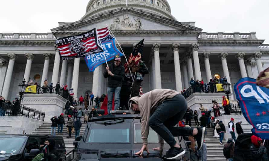 A mob outside the US Capitol building in Washington DC on 6 January.