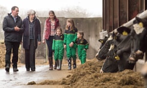 Theresa May is shown around Fairview Farm, Bangor, during her UK tour.