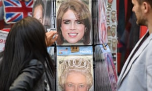 Cardboard masks of Princess Eugenie and other royals in Windsor.
