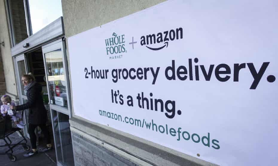 A sign promoting the Amazon Prime Now delivery service is displayed outside a Whole Foods store in Cincinnati on 8 February 2018.