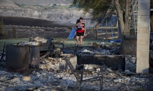 Kelsey Thorne holds her daughter Nevaeh Porter, 8, as they both cry while viewing the remains of their home where on the Ashcroft First Nation, near Ashcroft, British Columbia.