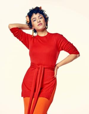 Actor Alia Shawkat in a long red dress