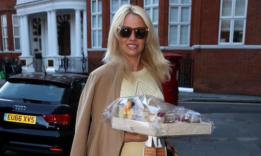 Pamela Anderson arrives at the Ecuadorian embassy in Knightsbridge, London, holding a gift basket