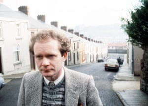 Martin McGuinness pictured in Derry with Rossville Flats in background