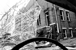 The 16th Street Baptist church in Birmingham, Alabama, was bombed by white supremacists on 15 September 1963, killing four black girls. The church is seen here two days later through the bomb-damaged windscreen of a car