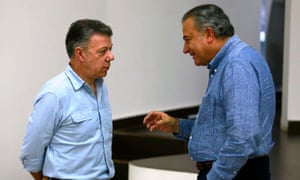 President Juan Manuel Santos, left, and Vice-President Oscar Naranjo. 'The immense majority of the testimony signals the police as responsible,' Naranjo said.