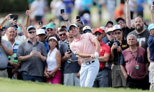 Rory McIlroy plays a shot on the 16th during his third round at the Arnold Palmer Invitational in Orlando, the day after his return visit to Disney World.