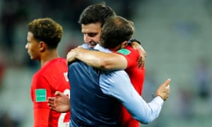 Gareth Southgate embraces Harry Maguire after England's win 2-1 Tunisia.