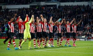 PSV celebrate at the end of the match.