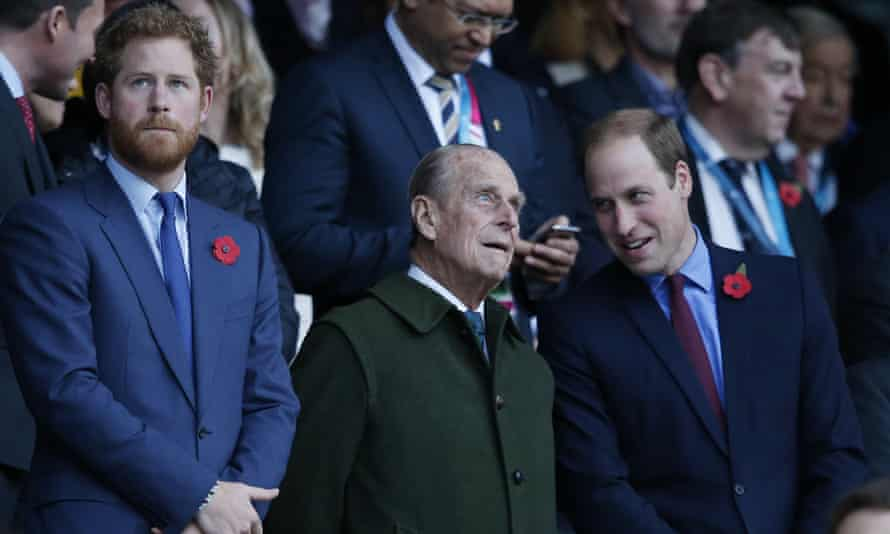 Prince Harry and his brother Prince William with their grandfather the Duke of Edinburgh in 2015. Prince Philip's funeral will take place at St George's chapel, Windsor Castle, on Saturday.