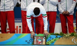 Iran's gold medalists brought a picture of Bahman Golbarnezhad onto the podium with them.