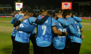 The Sussex team form a huddle before fielding.